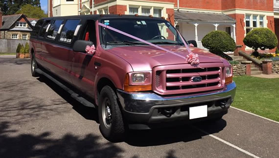 Hummer style American SUV with pink interior and 16 seats