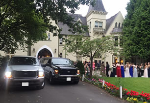 Two limousines at a wedding venue